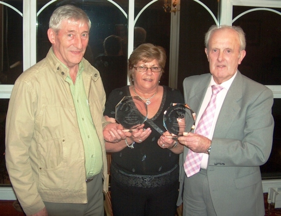 Founding members Patsy McCann and Norman Doherty receive their commemorative plaques from Anne Donnelly at last years 25th Anniversary Dinner Dance.